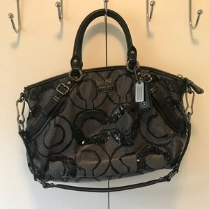 Beautiful coach bag with sequins. Black